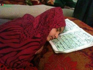 Little Girl sleeps on Quran
